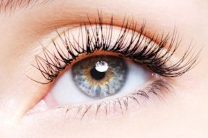5859098 - woman eye with a curl false eyelashes - low angle view